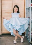 Світло блакитна атласна нарядна сукня на дівчинку 7 років