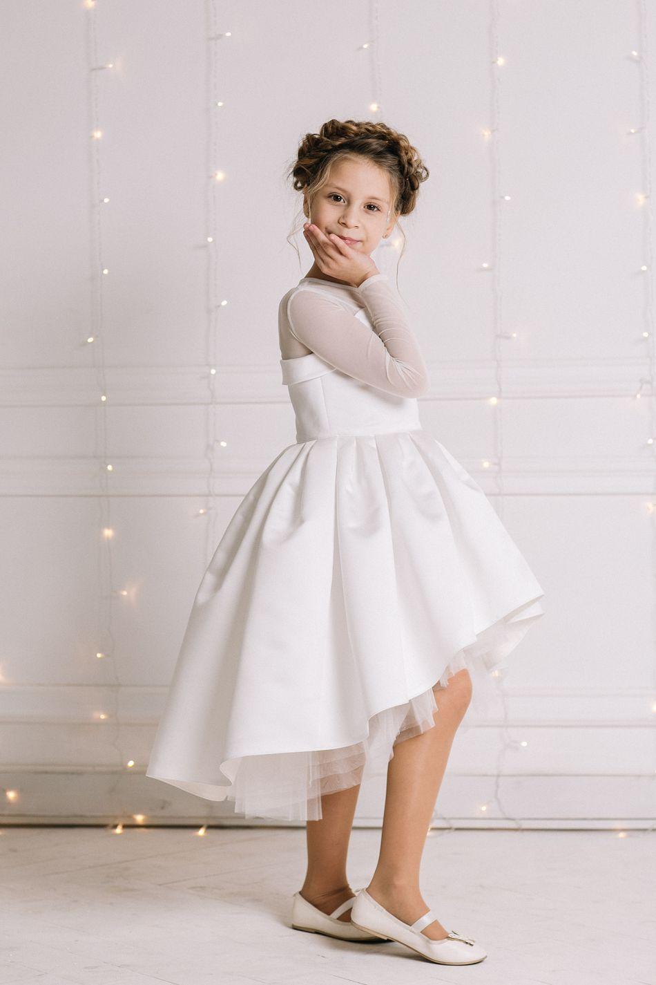 Ніжна біла святкова сукня на дівчинку