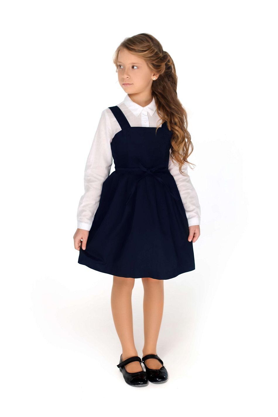 синій шкільний сарафан дівчинці