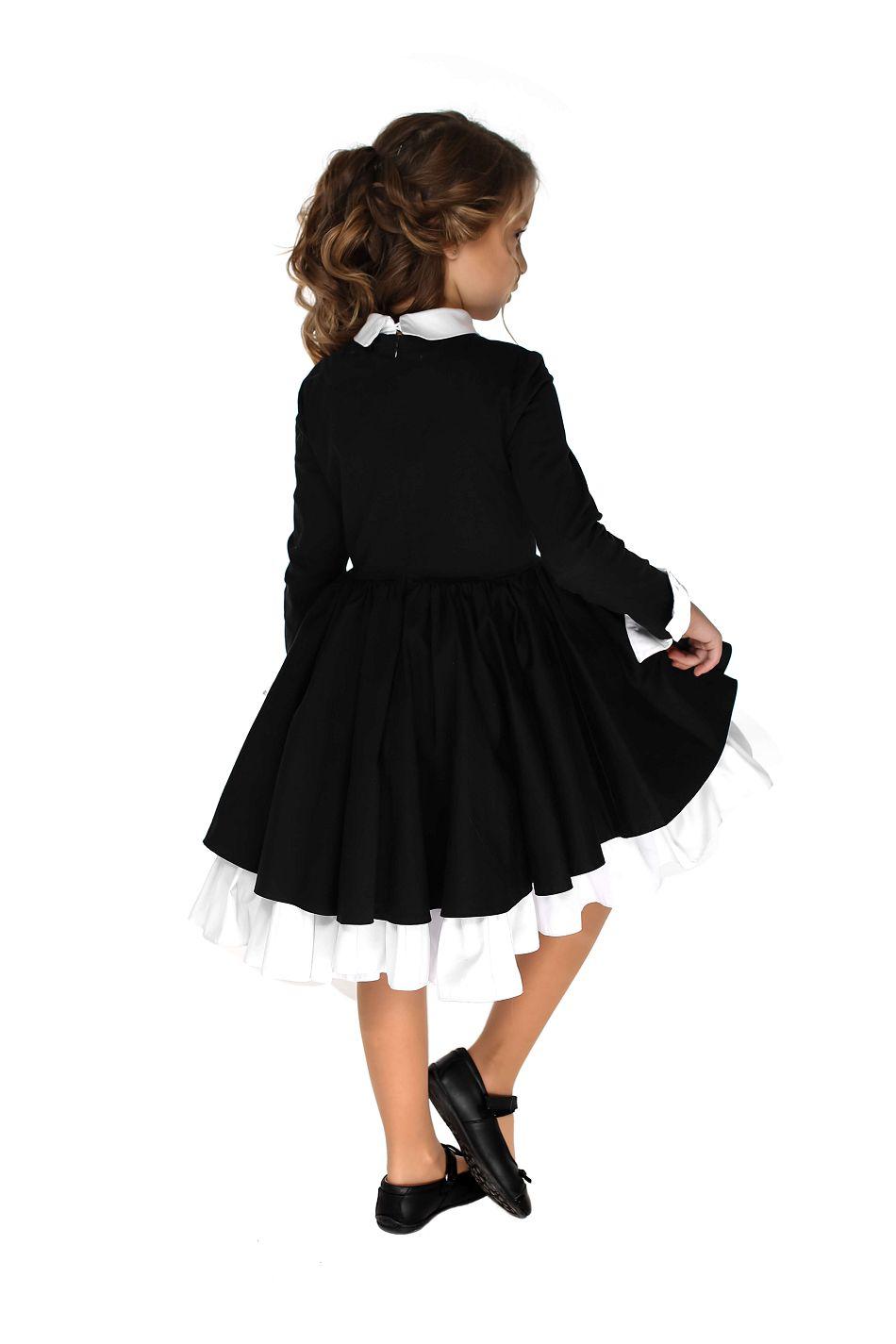 Елегантна шкільна сукня на дівчинку