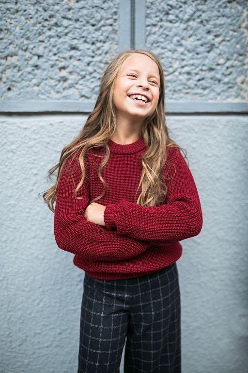 теплий светер на дівчинку